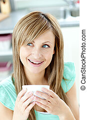 Cute woman holding a cup a coffee a