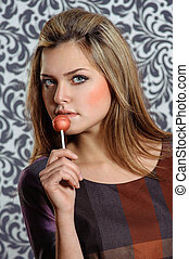 cute woman holding lollipop