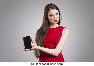 Cute woman holding smart phone