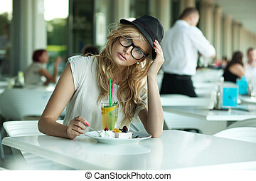 Cute woman in a cafe
