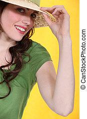 Cute woman in a straw hat