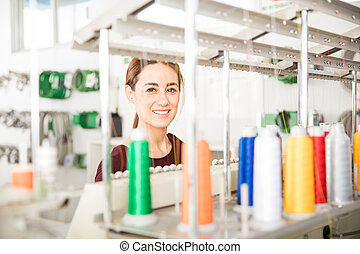 Cute woman in a textile factory