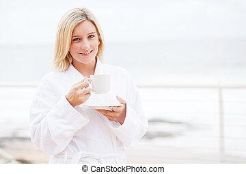 cute woman in bathrobe drinking coffee - cute young woman in...