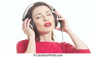 Cute woman in red listening