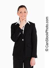 Cute woman in suit posing