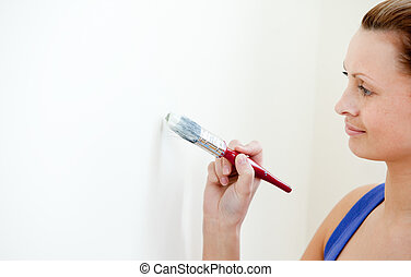 Cute woman is decorating a room