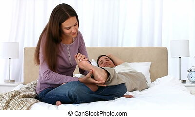 Cute woman massaging her boyfriend