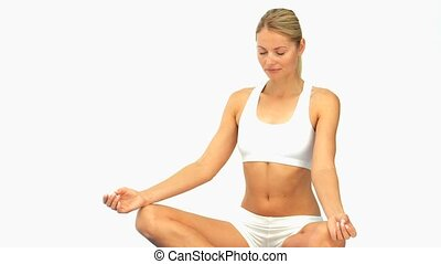 Cute woman meditating isolated on a white background