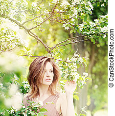 Cute Woman Outdoors on Floral Background