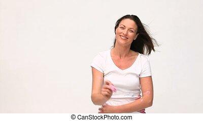 Cute woman painting towards the camera