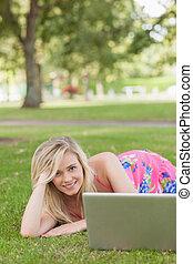 Cute woman posing on a lawn