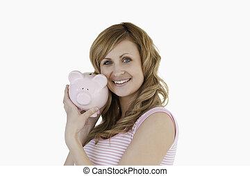 Cute woman posing with her piggybank