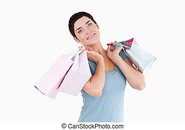 Cute woman posing with shopping bags