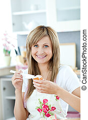 Cute woman preparing a cake in the