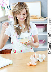 Cute woman preparing a meal in the kitchen