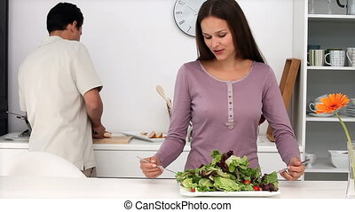 Cute woman putting salt and pepper