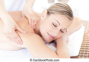 Cute woman receiving a back massage in a Spa center