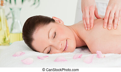 Cute woman receiving a massage in a spa
