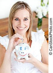 Cute woman saving money