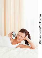Cute woman showing her mobile