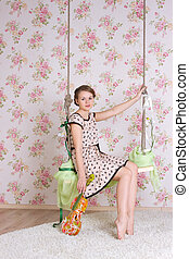 woman sitting on the swing