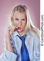 Cute woman smoking a cigar dressed with tie and shirt