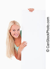 Cute woman standing behind a whiteboard