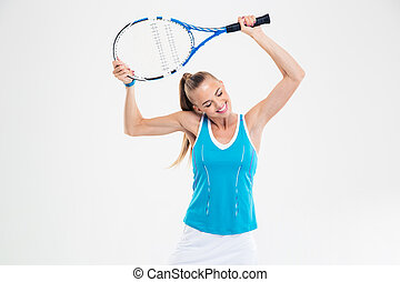 Cute woman standing with tennis racket