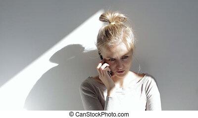 Cute woman talking on phone