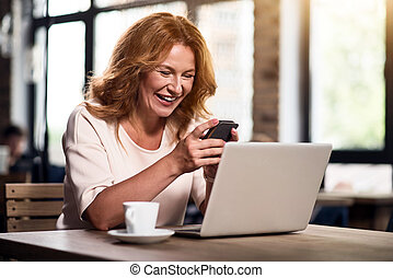 Cute woman using smart phone