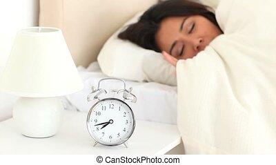 Cute woman waking up