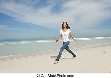 Cute woman walking exercise beach