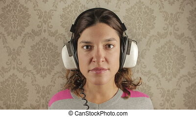 cute woman wearing different retro headphones