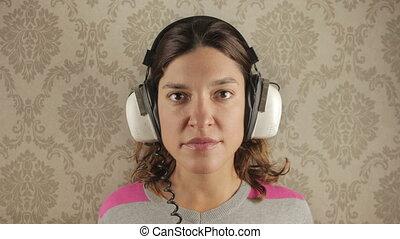 cute woman wearing different retro headphones