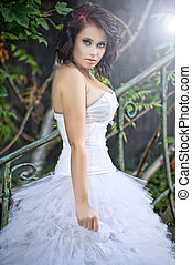 Cute woman wearing wedding dress