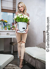 Cute woman with a bouquet in hands