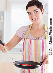 Cute woman with a pan