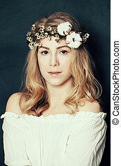 Cute woman with fair hair and flowers