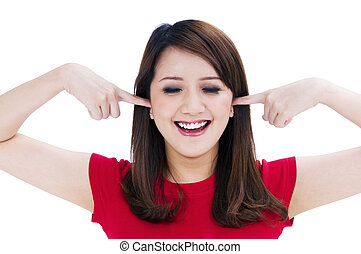 Cute woman with fingers in her ears