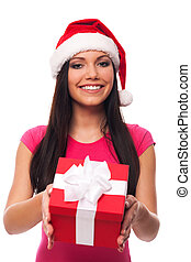 Cute woman with santa hat giving christmas gift