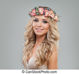 Cute Woman with Spring Flowers, Long Wavy Hair and Makeup