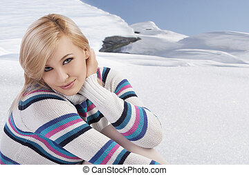 cute woman with wool sweater looking at the camera