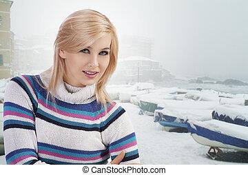 cute woman with wool sweater posing towards camera