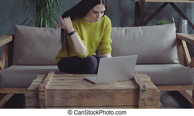 Cute woman working on laptop