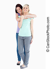 Cute Women hugging in a studio