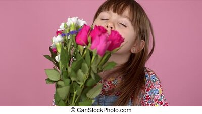 Cute young adorable girl holding and smell bouquet of fresh ...