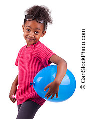 Cute young African American girl holding a blue balloon