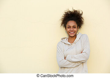 Cute young african american woman smiling