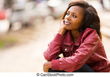 young african woman daydreaming - cute young african woman...