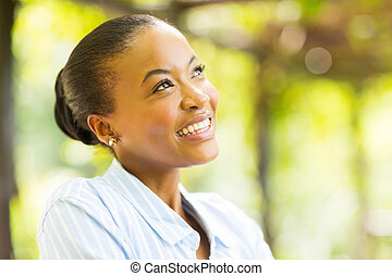 young african woman daydreaming